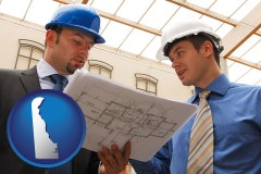 delaware two architects reviewing blueprints