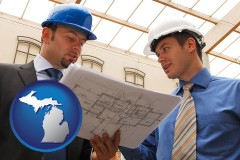 michigan two architects reviewing blueprints