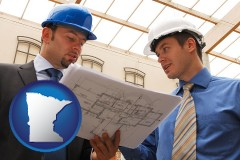 minnesota two architects reviewing blueprints