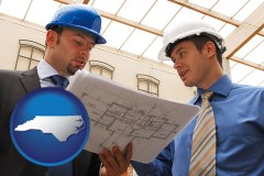 north-carolina two architects reviewing blueprints