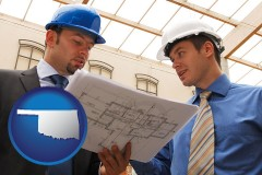 oklahoma two architects reviewing blueprints