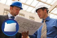 oregon two architects reviewing blueprints