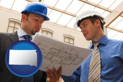 south-dakota two architects reviewing blueprints