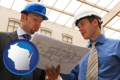 wisconsin two architects reviewing blueprints