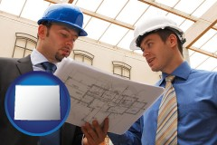 wyoming two architects reviewing blueprints