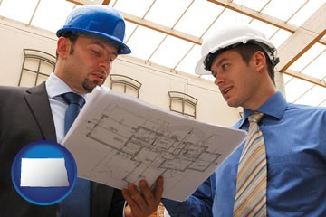 two architects reviewing blueprints - with North Dakota icon