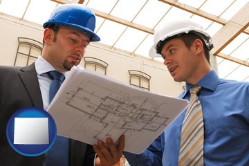 two architects reviewing blueprints - with Wyoming icon